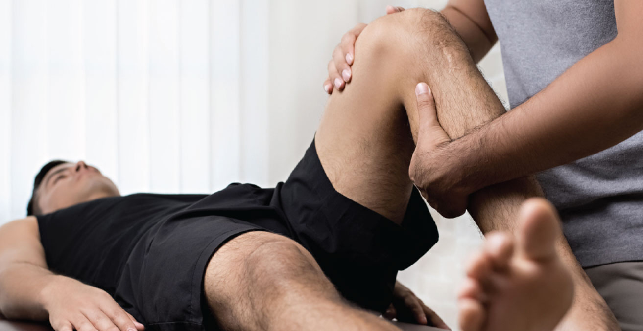Physio assessing a knee